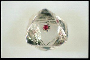 This is a diamond with a garnet inclusion from Siberia.